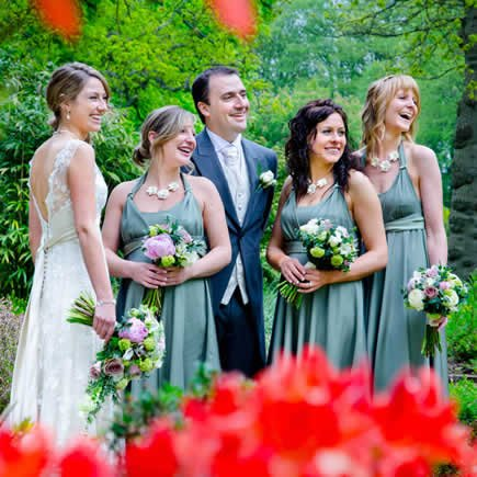 Bride and bridesmaids in seafoam dresses at Chartridge Lodge Hotel Bucks - Mark Sisley Photography