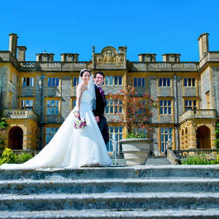 Bride and groom on steps at Eynsham Hall - Mark Sisley Photography