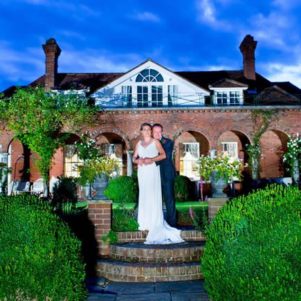 Bride and groom at twilight at their wedding at Micklefield Hall - Mark Sisley Photography