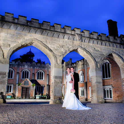 Dramatically lit image of bride and groom at twilight - Nether Winchendon House Buckinghamshire - Mark Sisley Photography