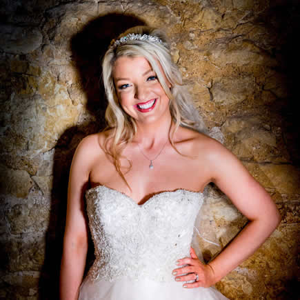 Bride in front of stone wall at Notley Tythe Barn Buckinghamshire - Mark Sisley Photography