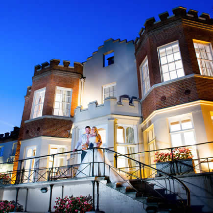 Bride and groom on staircase outside Taplow House Hotel Buckinghamshire - Mark Sisley Photography
