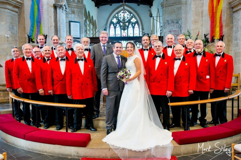 Bride and groom with choir - wedding at the Dairy Waddesdon Manor - Mark Sisley Photography