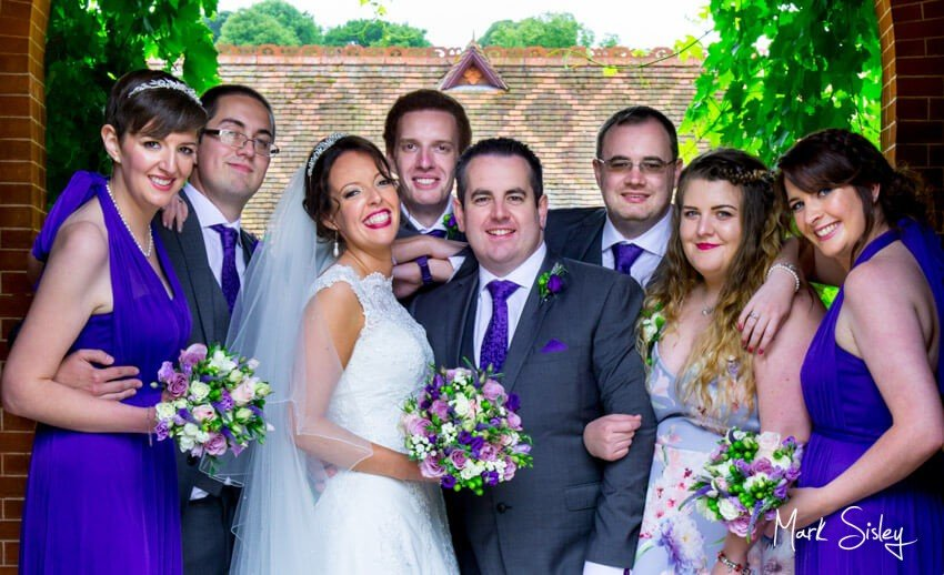 Bridal party in archway at The Dairy Waddesdon Manor - Mark Sisley Photography