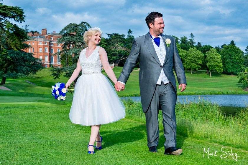 Bride and groom on the lawn at Brocket Hall - wedding at Brocket Hall - Mark Sisley Photography