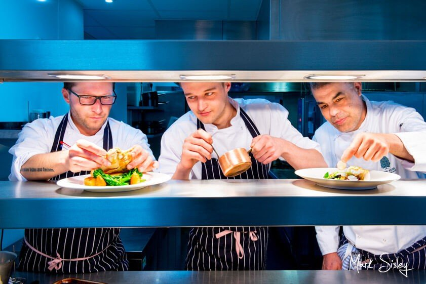 chefs plating food at corporate event - Mark Sisley Photography