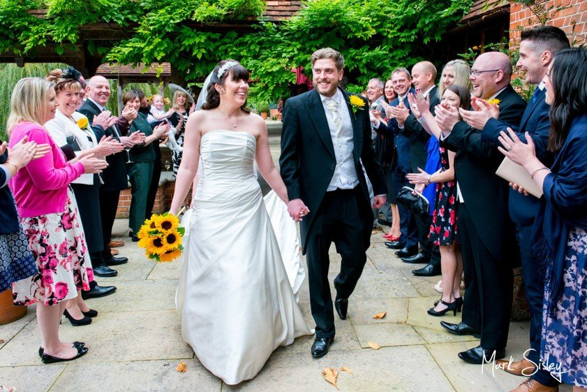 Bride and groom and wedding guests - wedding at The Dairy Waddesdon Manor - Mark Sisley Photography
