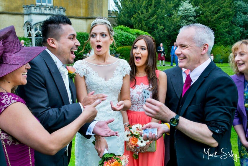 Magician and wedding guests - wedding at Missenden Abbey - Mark Sisley Photography