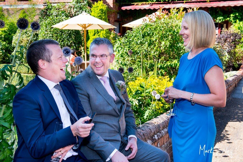 wedding guests laughing - wedding at The Five Arrows Waddesdon - Mark Sisley Photography