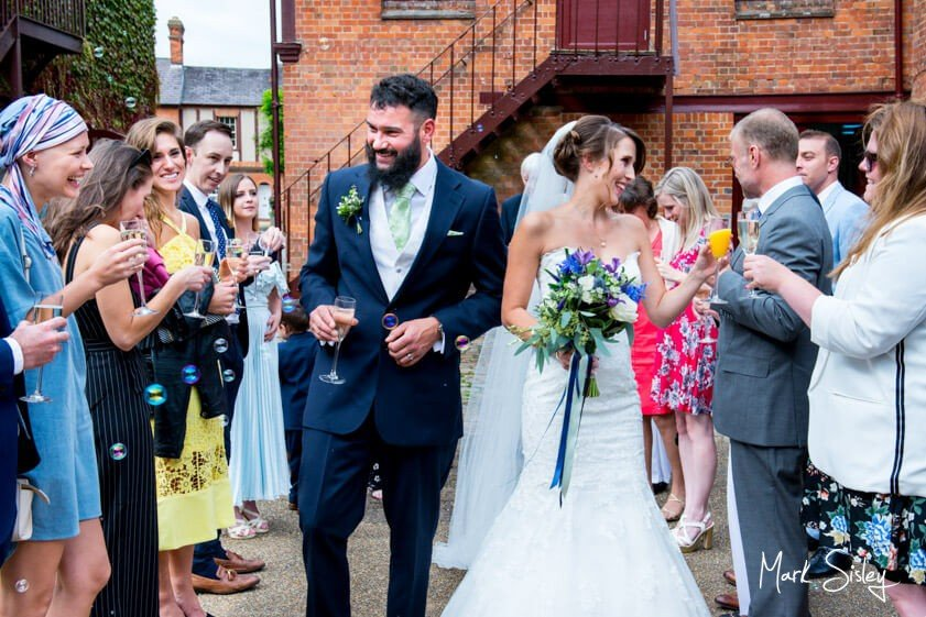Bride and groom and wedding guests - wedding at Five Arrows Waddesdon - Mark Sisley Photography