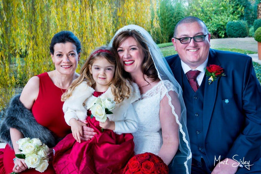 Bridal party with luxurious red roses at Waddesdon Manor - Mark Sisley Photography