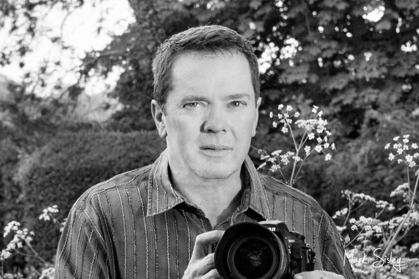 Black and white image of photographer - Mark Sisley Photography