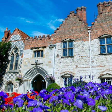 Bisham Abbey wedding venue with purple flowers in foreground