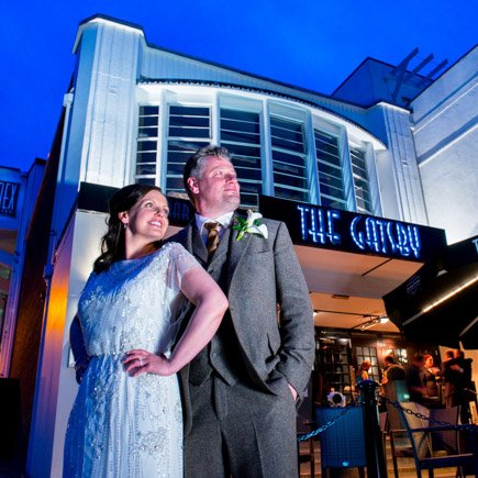 Bride and groom in front of Gatsby Cinema Berkhamsted Hertfordshire on their wedding day