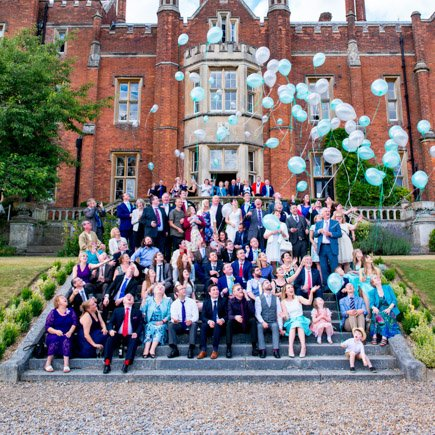 Wedding guests on steps at Latimer Estate Buckinghamshire