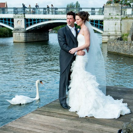 Bride and groom and swan River Thames at Windsor Sir Christopher Wren House Hotel wedding
