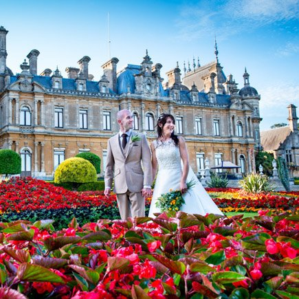 Bride and groom captured through the flowers at Waddesdon Manor Buckinghamshire