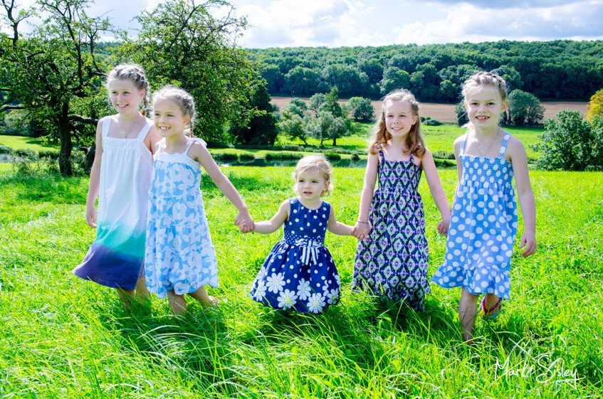 children playing in a meadow - family photograph - Mark Sisley Photography