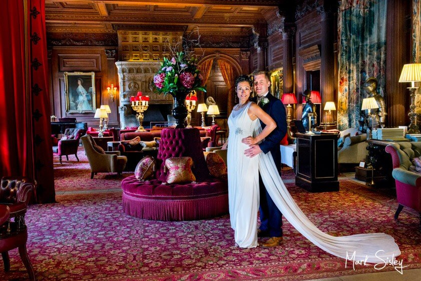 Bride and groom in the great hall - wedding at Cliveden House - Mark Sisley Photography