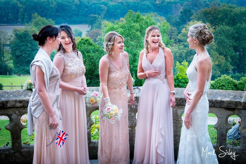 Bride and bridesmaids in blush gowns - Mark Sisley Photography