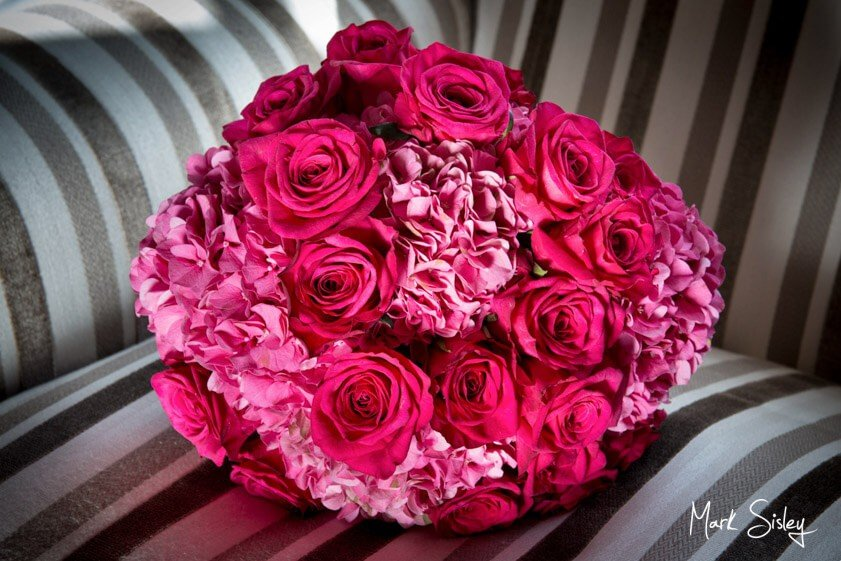 bouquet of hot pink roses and hydrangeas - Mark Sisley Photography