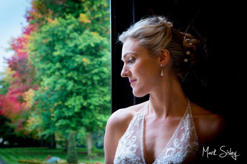 Bride gazing out the window - Mark Sisley Photography