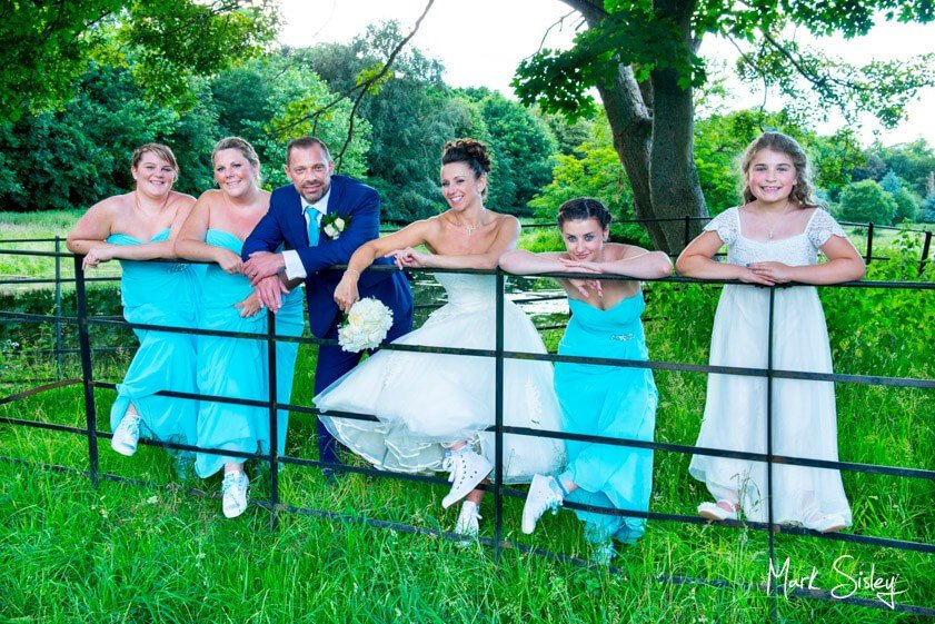 bridal party with turquoise gowns - Mark Sisley Photography