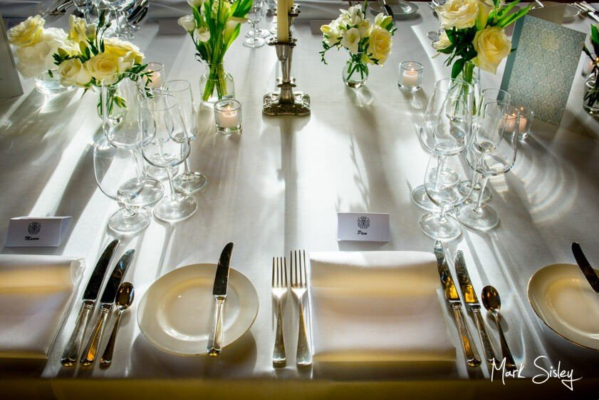 silver and white wedding dinner setting - Mark Sisley Photography