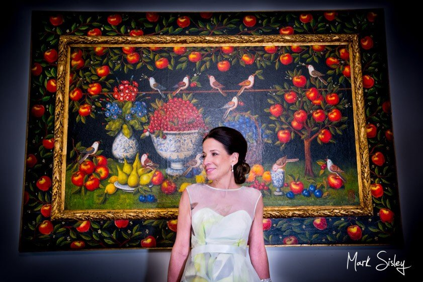 Bride in front of embroidered panel - Mark Sisley Photography