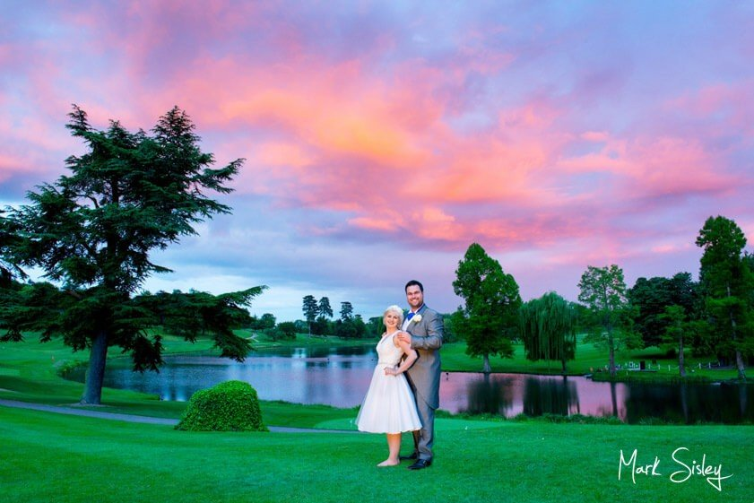 Bride and groom at sunset at Brocket Hall - Mark Sisley Photography