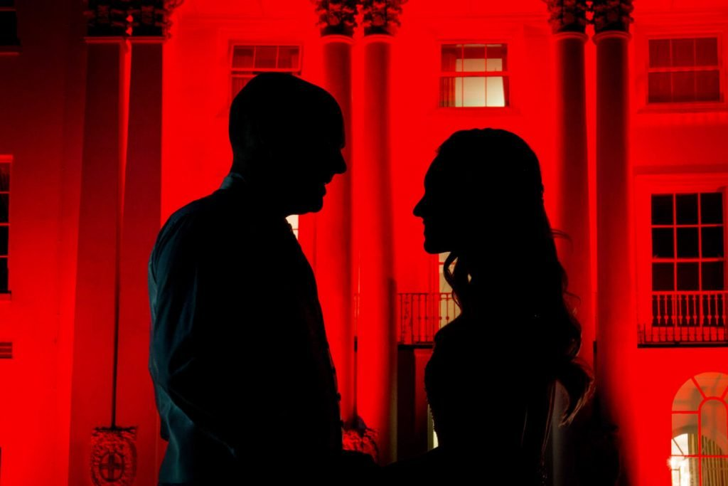 Beaumont Estate wedding photographs of the newlyweds in silhouette at the front of the floodlit hotel