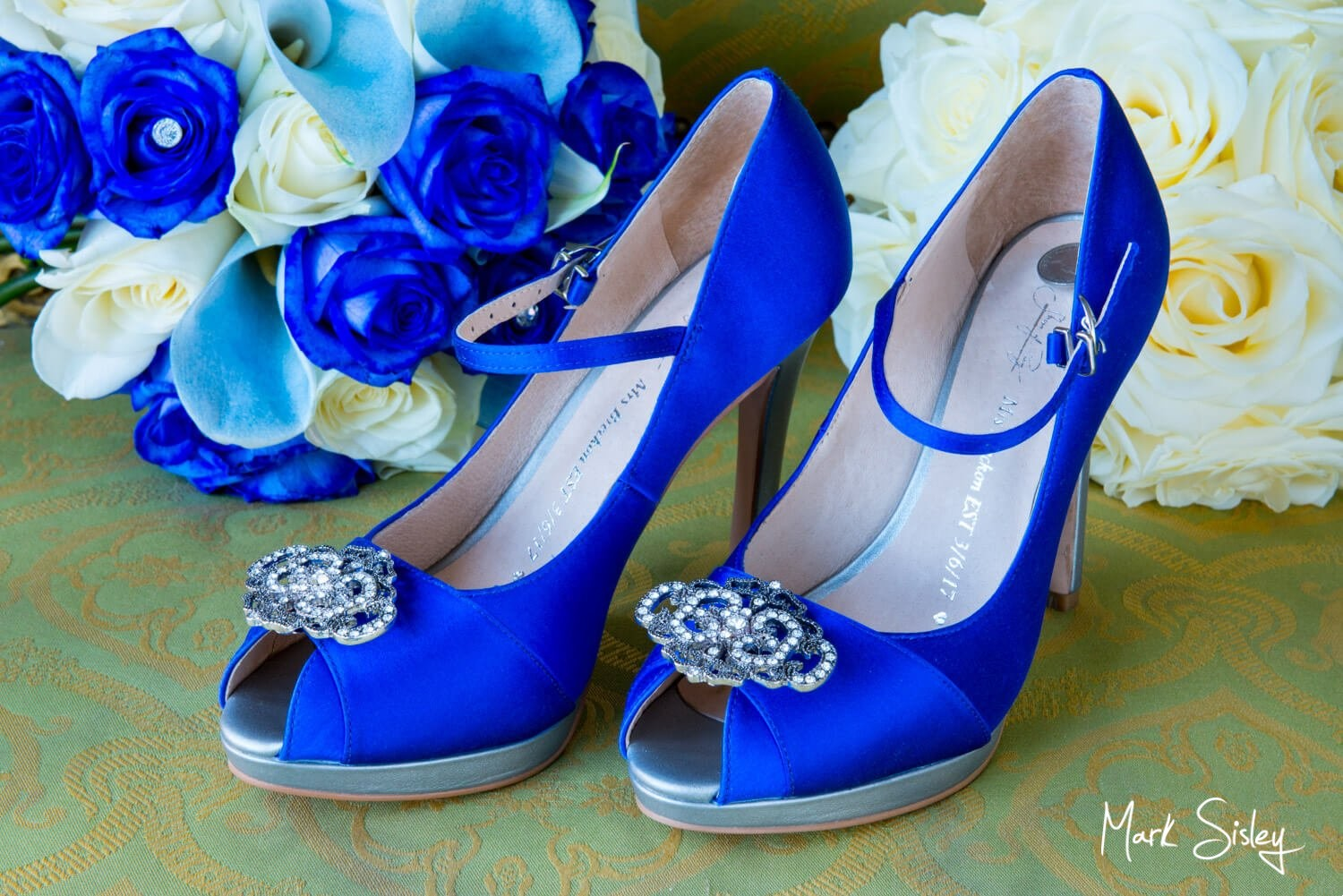 Brocket Hall wedding photography of bridal shoes and flowers