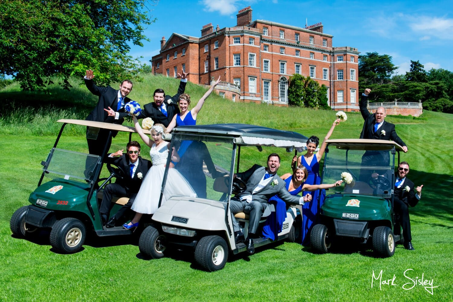 Brocket Hall buggies wedding photography in front of the main house