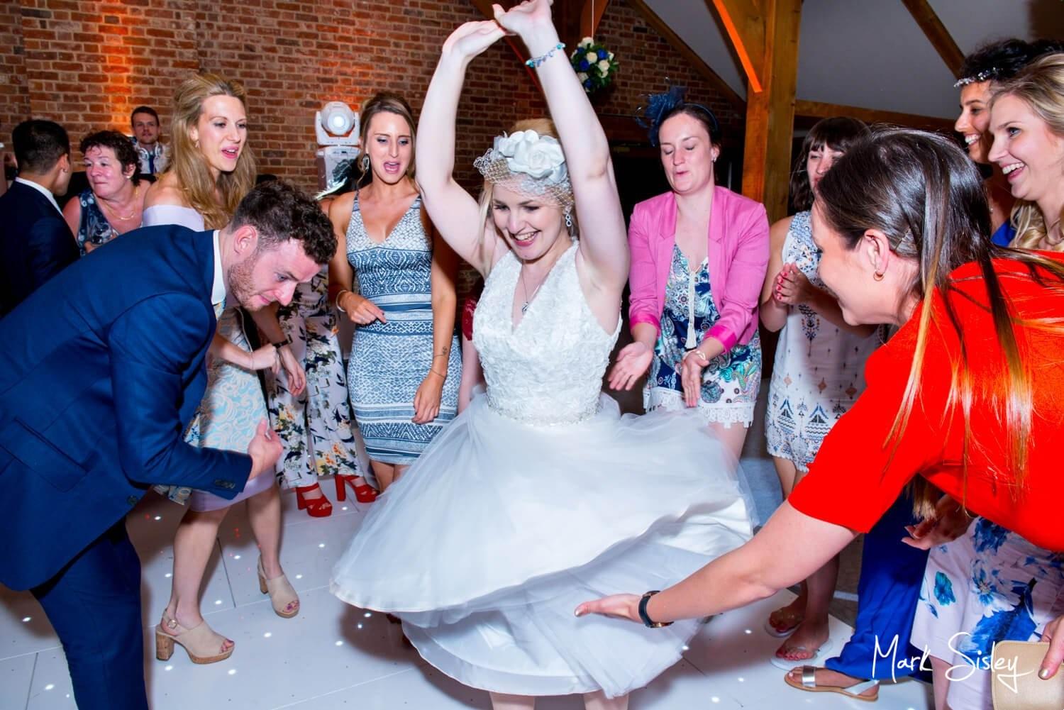 Brocket Hall wedding photography of the bride on the dancefloor