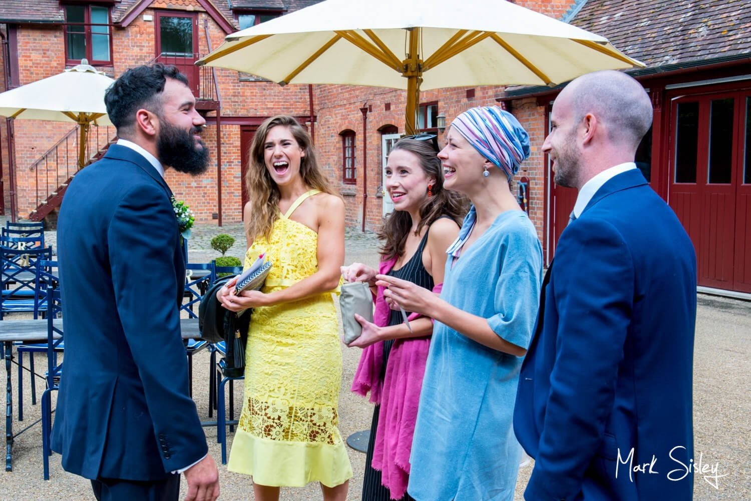 Five Arrows Waddesdon wedding guests greeted by the groom