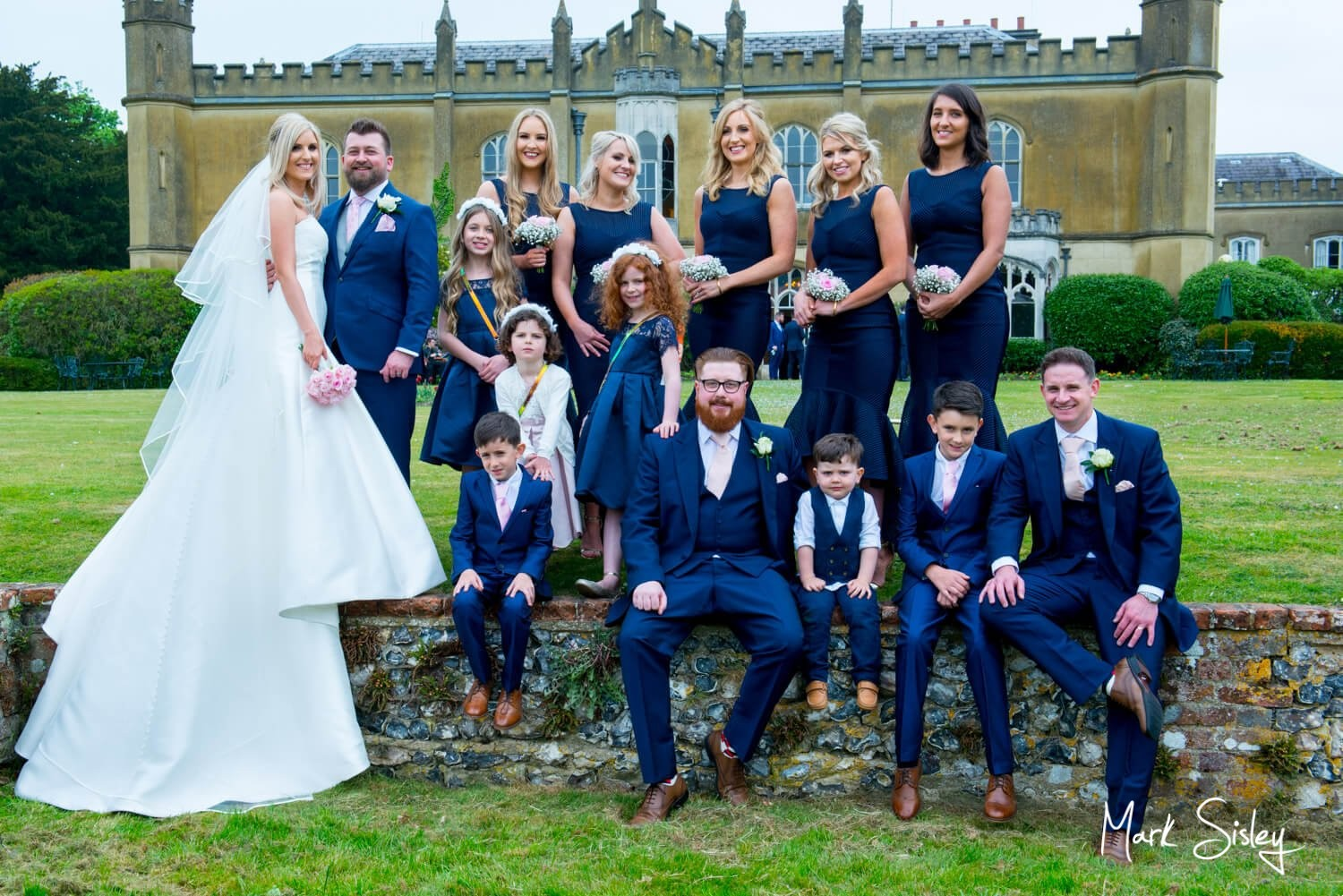 Missenden Abbey summer's wedding day pose with the bridal party