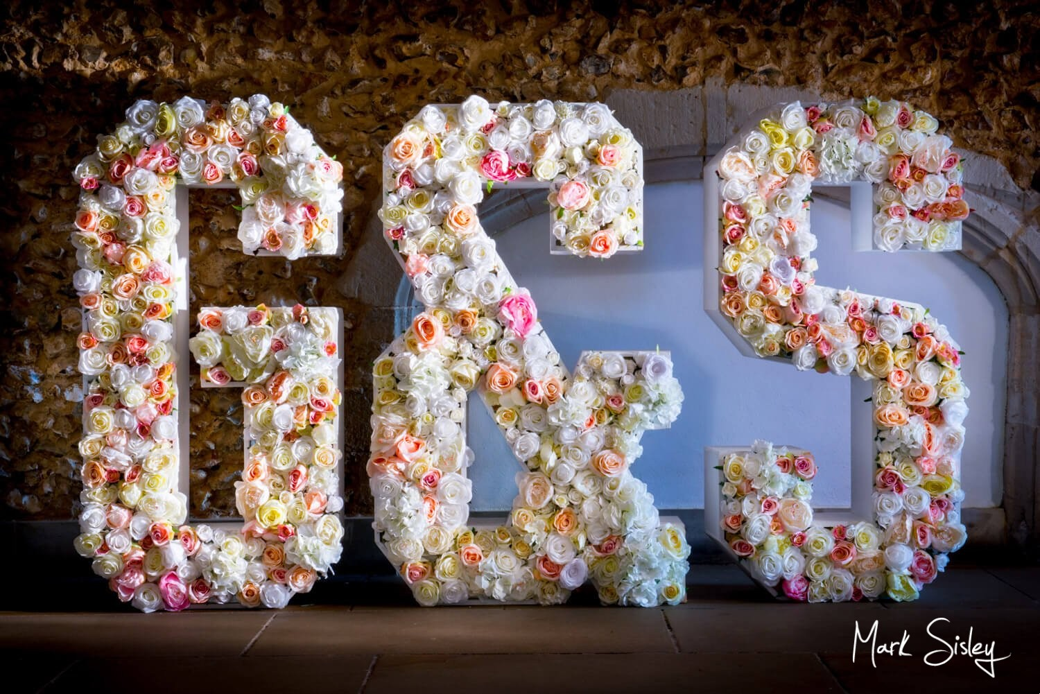 Missenden Abbey giant floral letters on a summer's wedding day