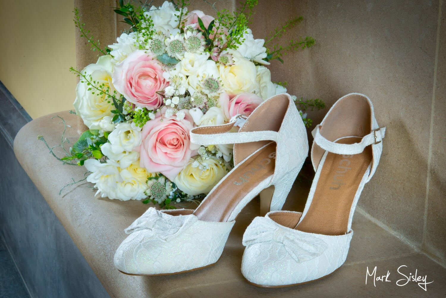 Bridal shoes and flowers at this magical Dairy Waddesdon wedding