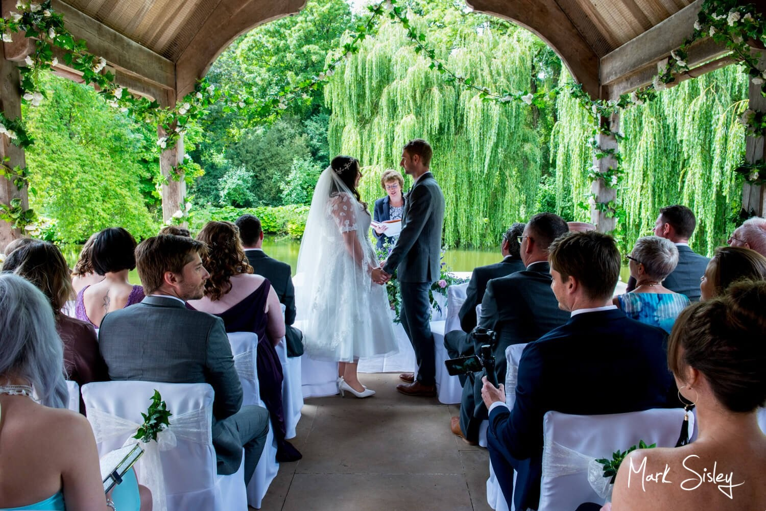Dairy Waddesdon wedding photos of the civil ceremony in progress outdoors