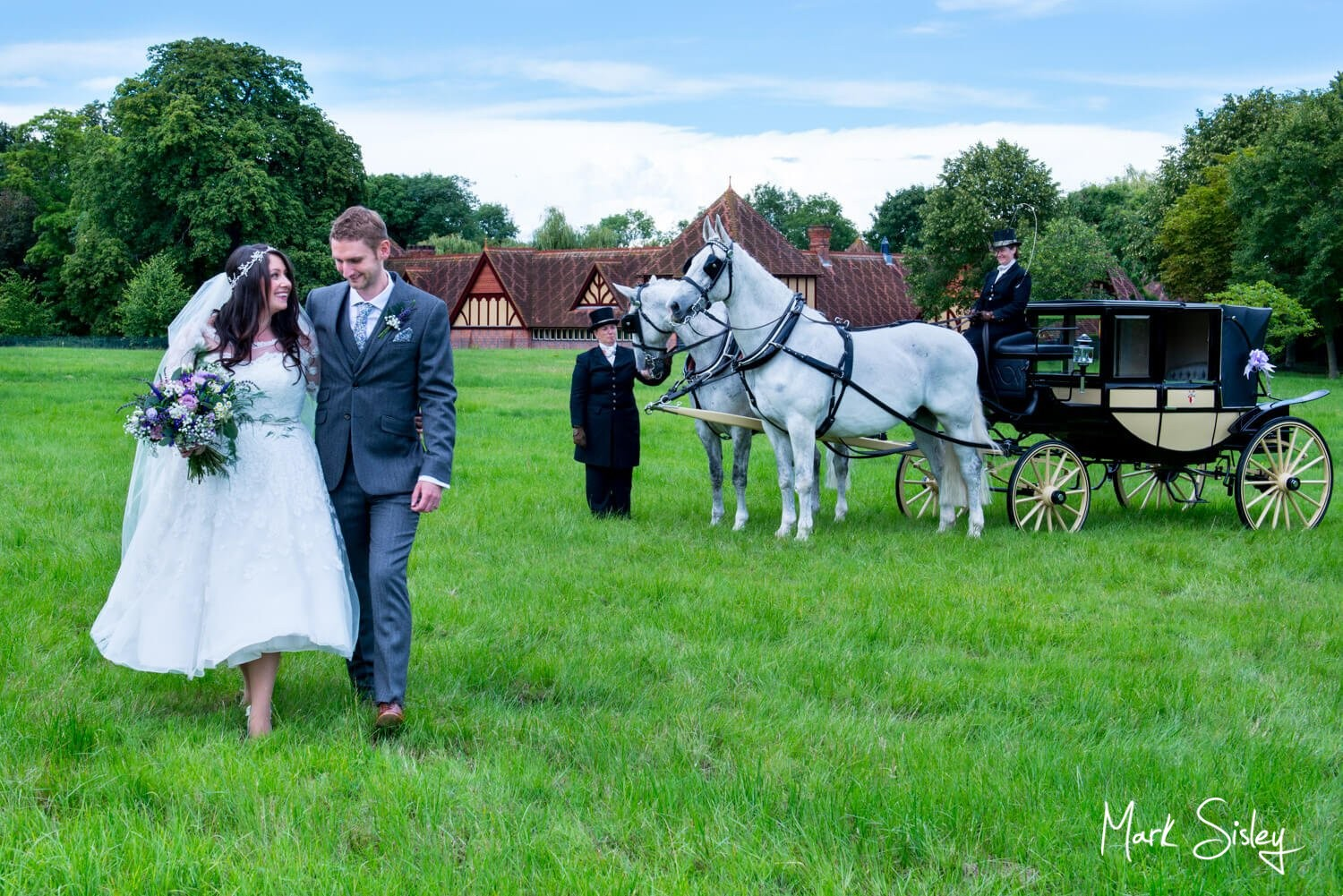 Dairy Waddesdon wedding photos of the newlyweds with their horses and carriage