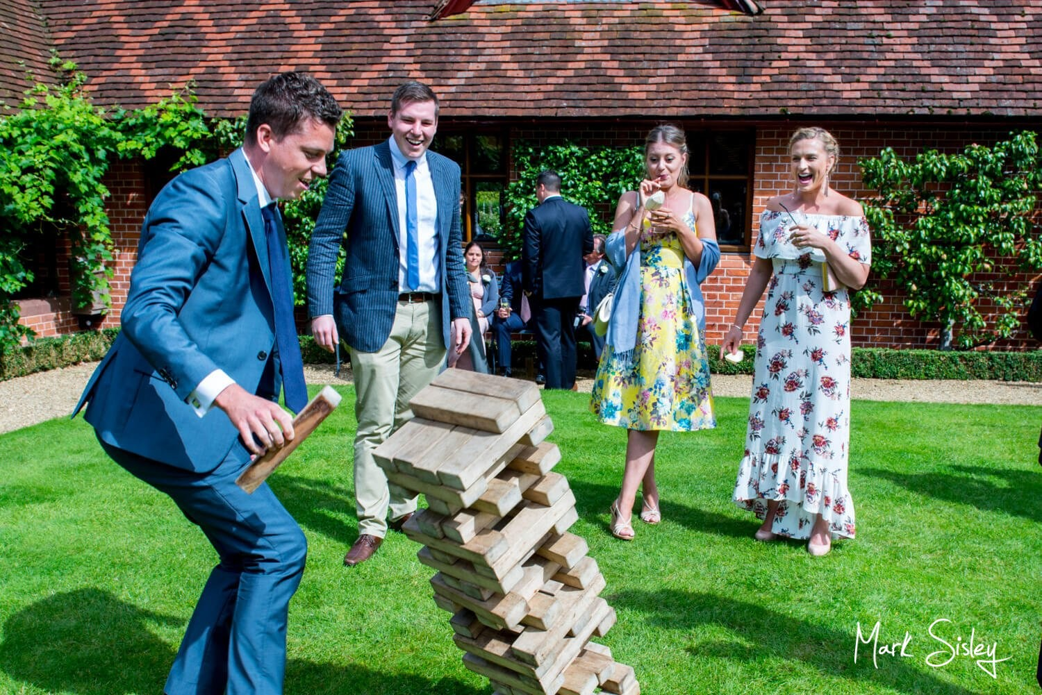 Dairy Waddesdon wedding photos of Jenga in the courtyard