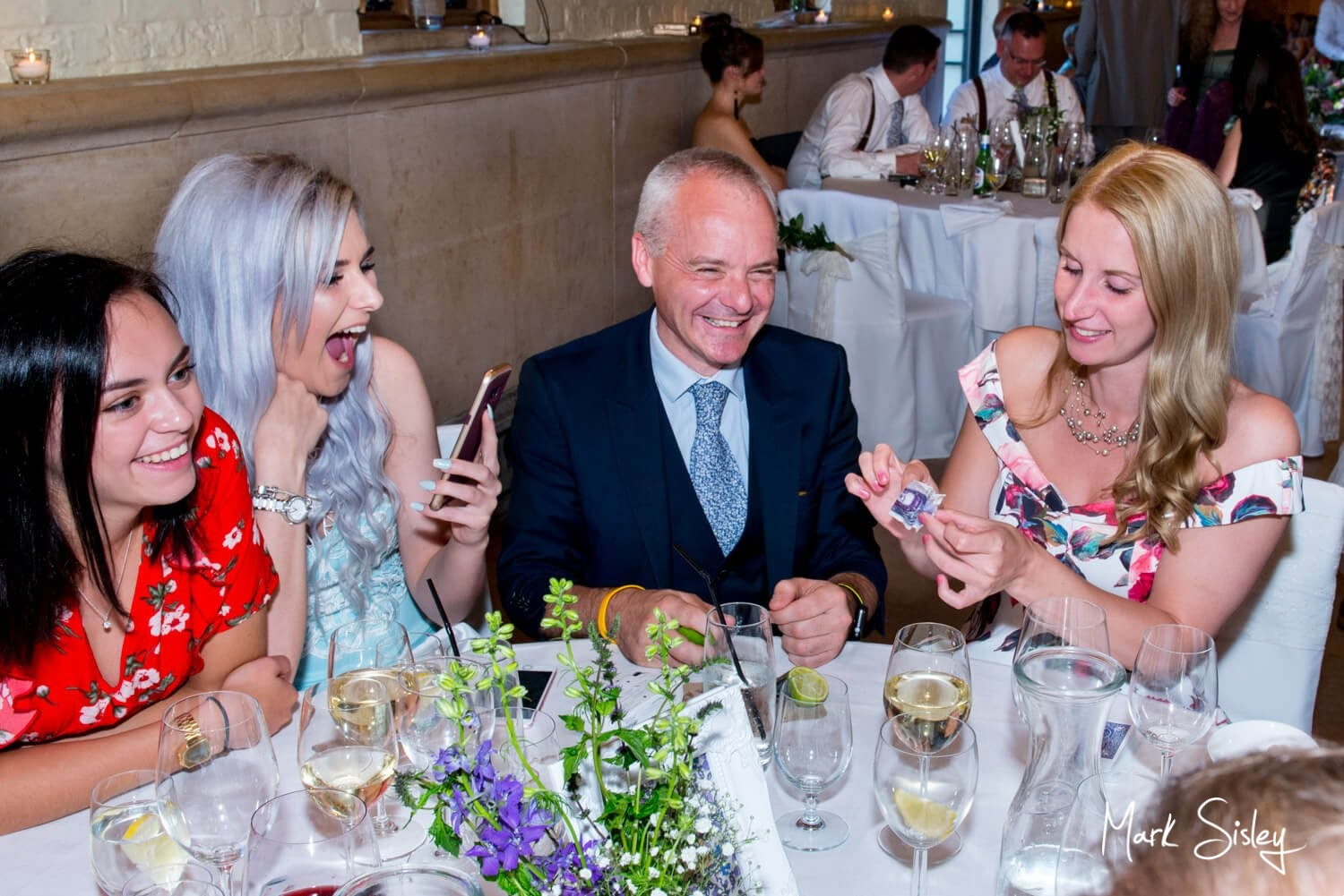 Dairy Waddesdon wedding photos of Paul Megram performing his magic tricks