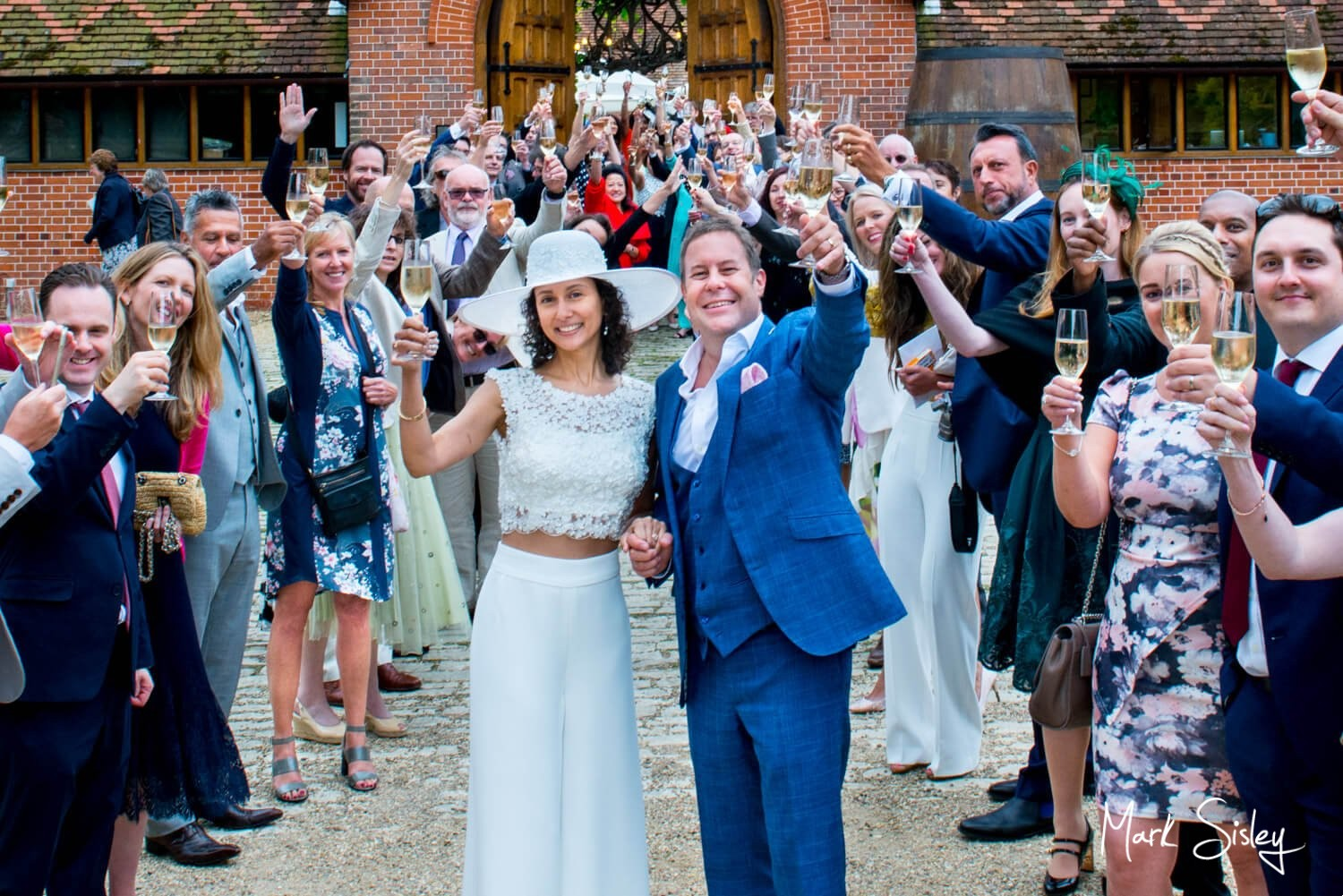 Summer Dairy Waddesdon wine themed newlyweds with their wedding guests