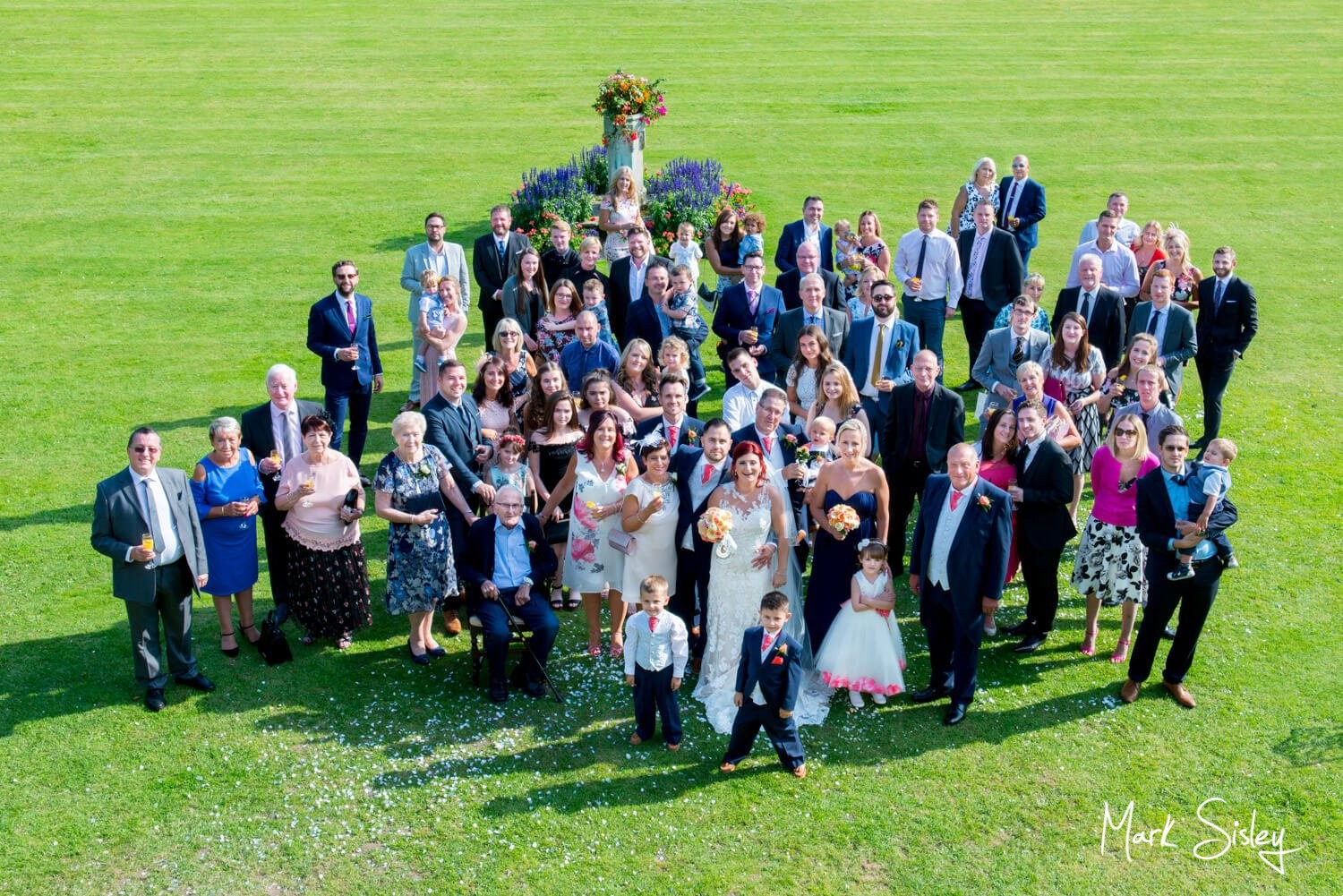 Large group pose at this Missenden Abbey wedding celebration