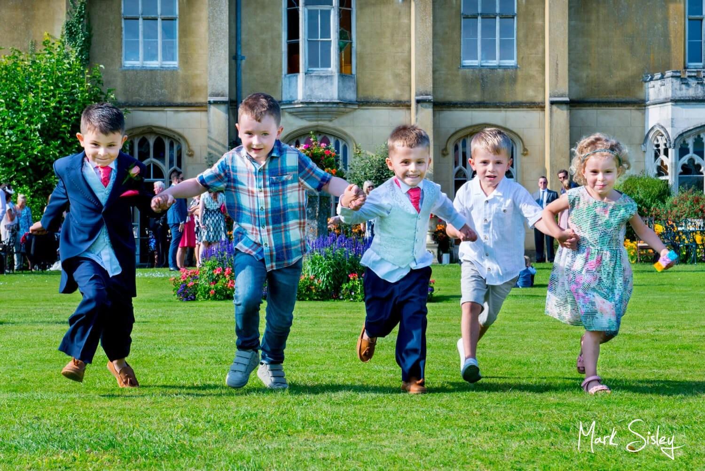 Children having fun at Missenden Abbey wedding celebration