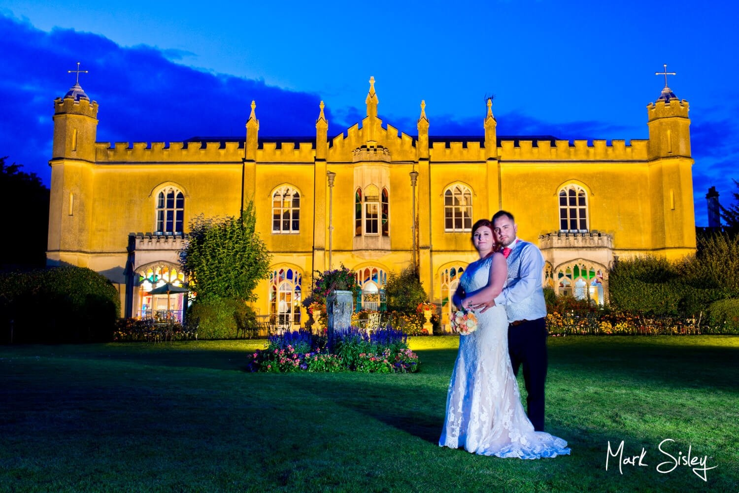 Missenden Abbey wedding celebrations comes to a close with this dramatic floodlit pose