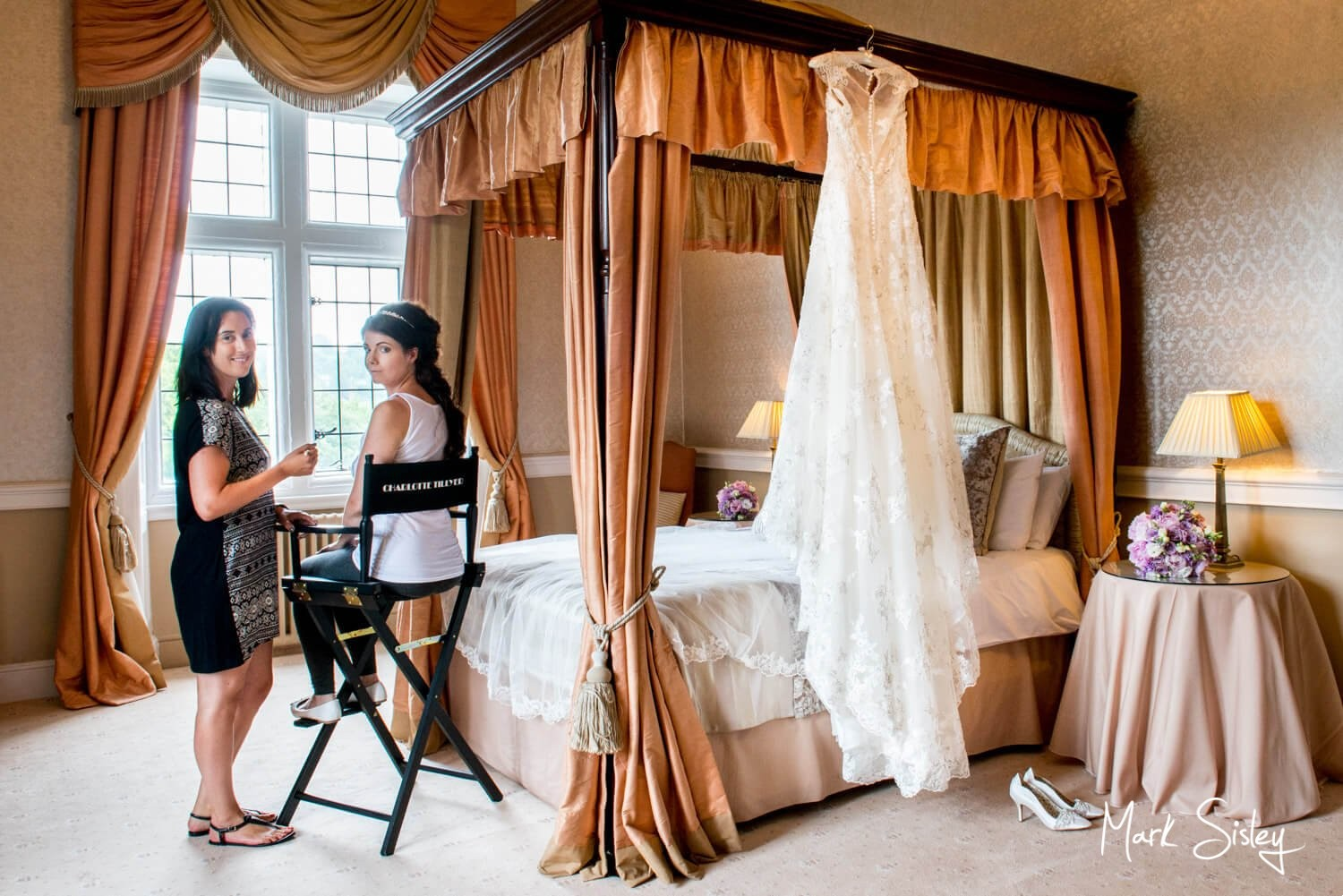 Clearwell Castle wedding image of the bride with her make-up artist on the morning