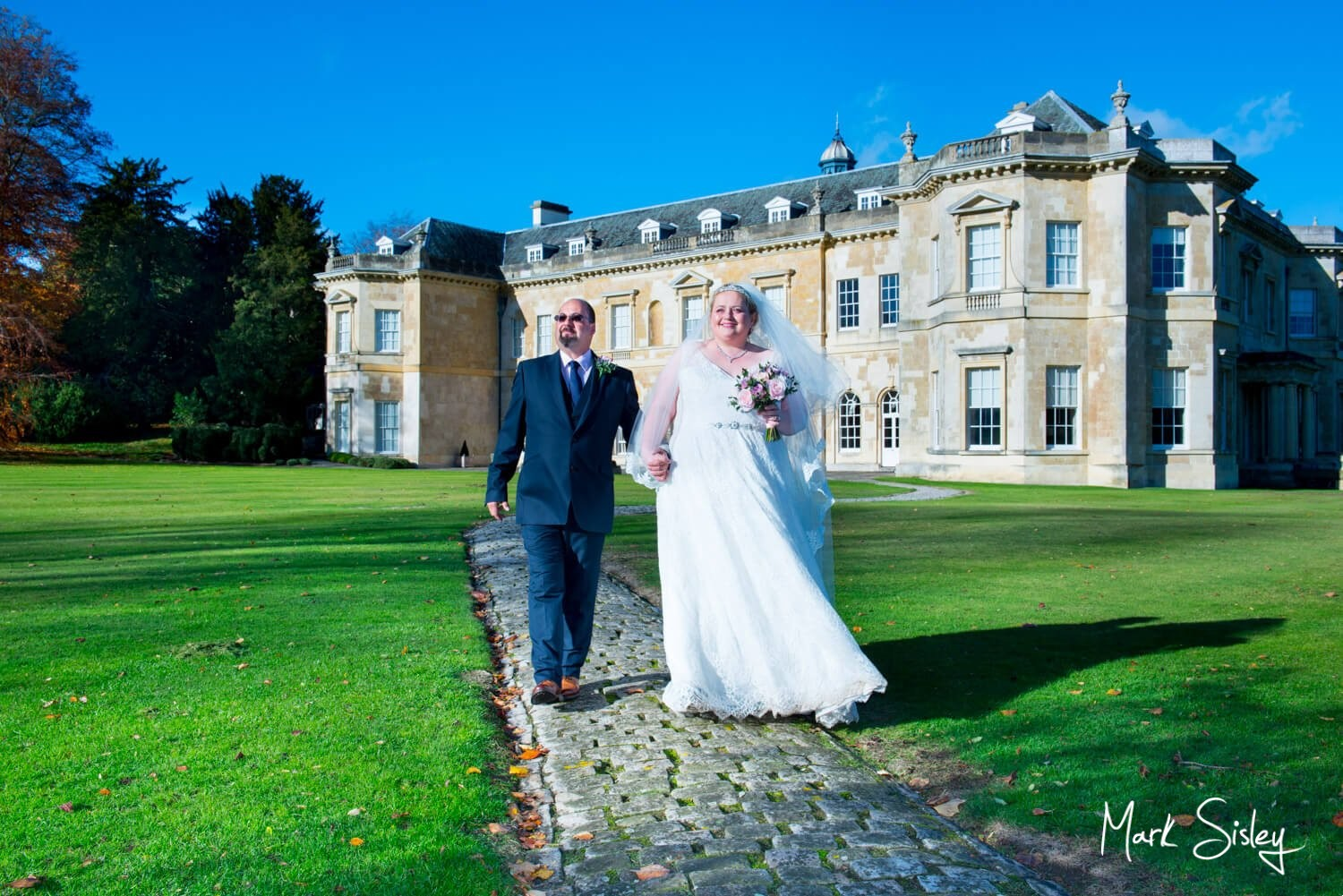 Hartwell House autumn wedding photography under perfect blue skies