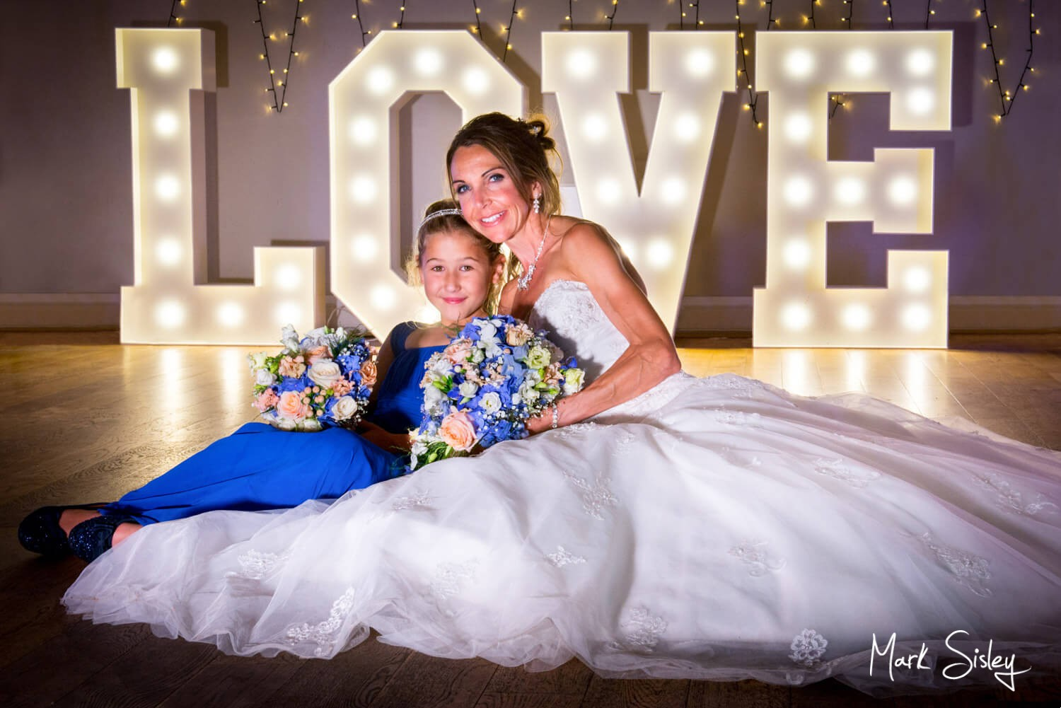 Monkton Barn wedding photography of the bride with her flowergirl