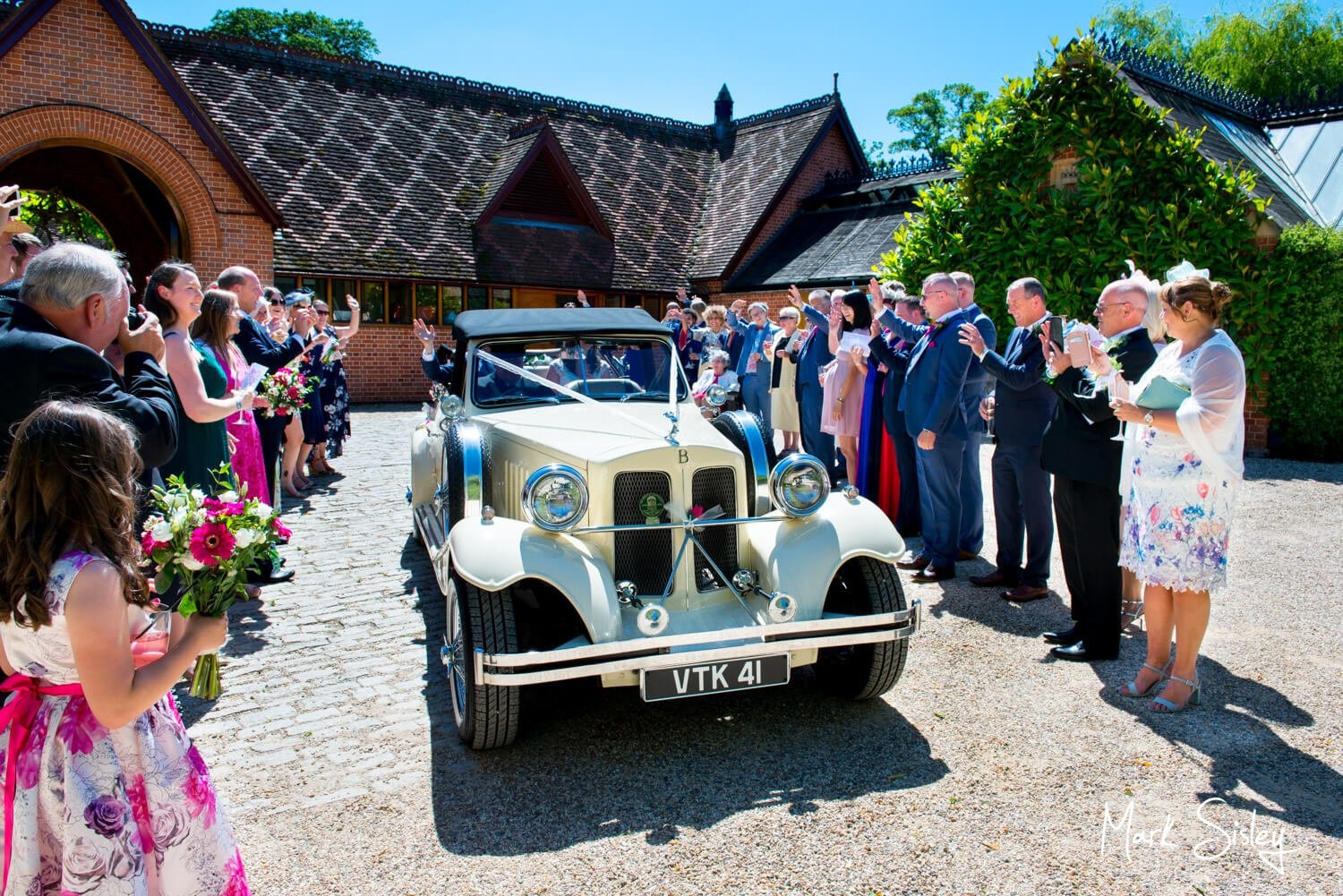 Dairy Waddesdon wedding car aisle on this couple's special day